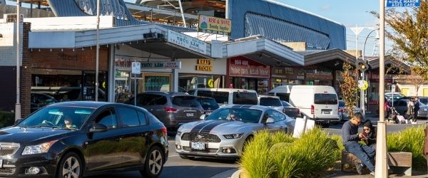 Photo of shops, cars and pedestrians in Noble Park