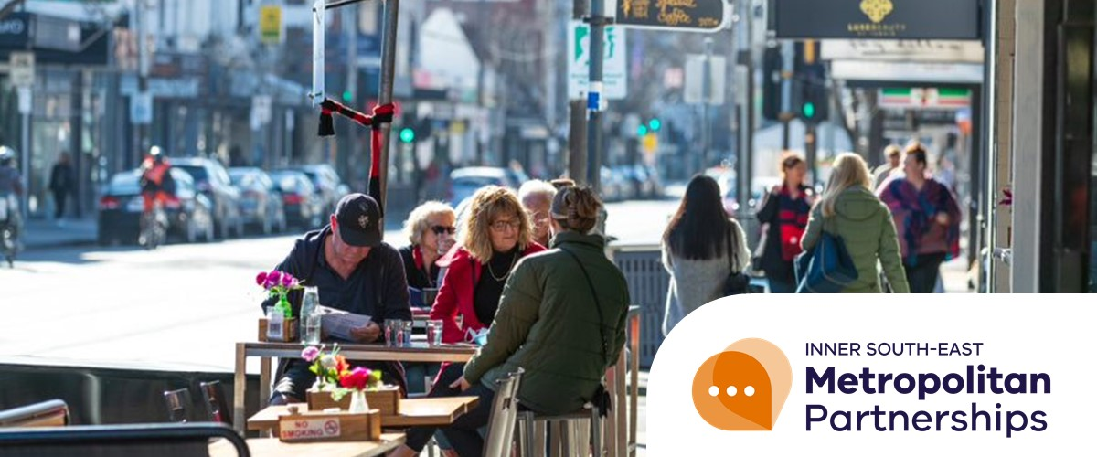 Photograph of people dining, and others walking, on Chapel Street South Yarra